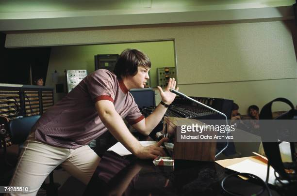 """Singer and mastermind Brian Wilson of the rock and roll band """"The Beach Boys"""" directs from the control room while recording the album """"Pet Sounds"""" in..."""