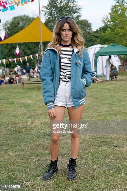 Singer and Model Whinnie Williams wears a NYC frith store jacket Doc Martens boots Uniqlo t shirt vintage Levi's shorts and sunglasses from a market...