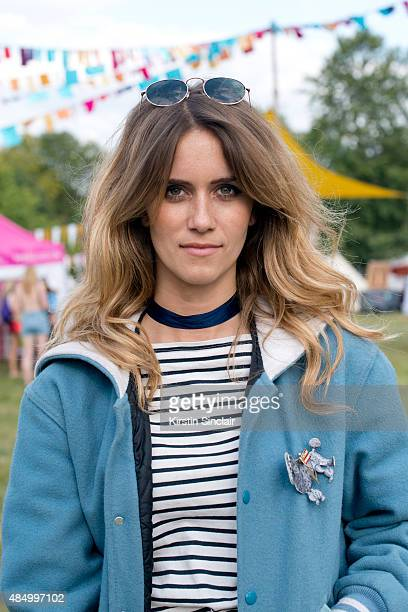 Singer and Model Whinnie Williams wears a NYC frith store jacket Uniqlo t shirt and sunglasses from a market on day 2 of the Wilderness Festival in...
