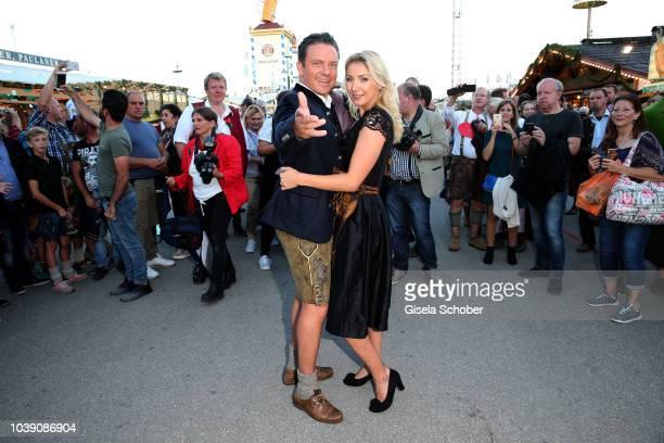 Singer and moderator Stefan Mross and his girlfriend AnnaCarina Woitschack during the 'Almauftrieb' as part of the Oktoberfest 2018 at Kaefer Tent at...