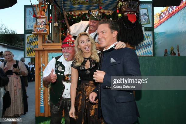 Singer and moderator Stefan Mross and his girlfriend AnnaCarina Woitschack with Vogeljakob during the 'Almauftrieb' as part of the Oktoberfest 2018...