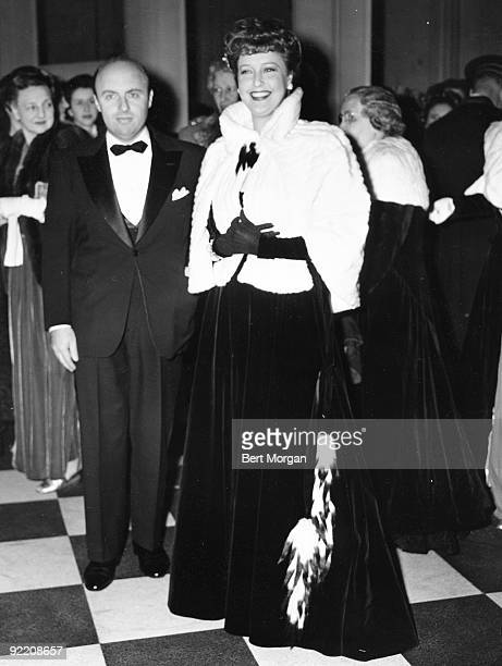 Singer and movie star Jeanette MacDonald stands with conductor Andre Kostelanetz at the opening of the Metropolitan Opera in NYC 1940