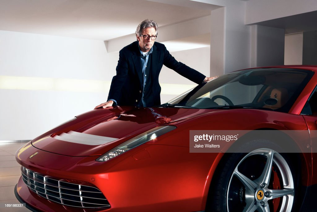 Singer and musician Eric Clapton is photographed with his custom built Ferrari SP12EC for Ferrari magazine on March 21, 2012 in London, England.