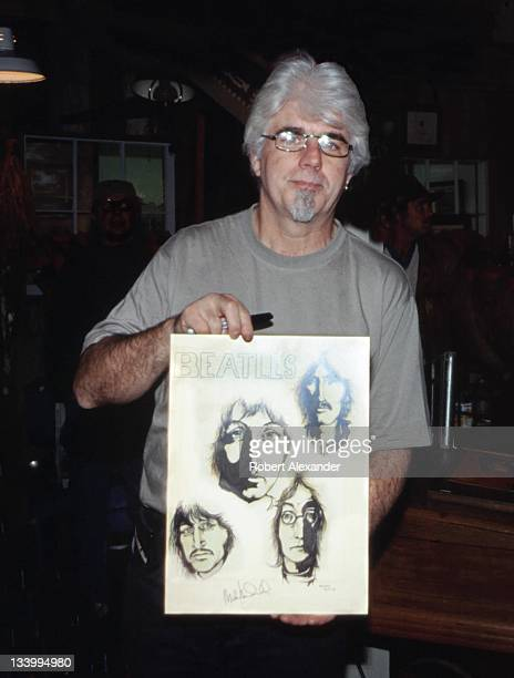 Singer and musician Michael McDonald holds his 1960's drawing of the Beatles in 2001 He was among several music industry celebrities who performed or...