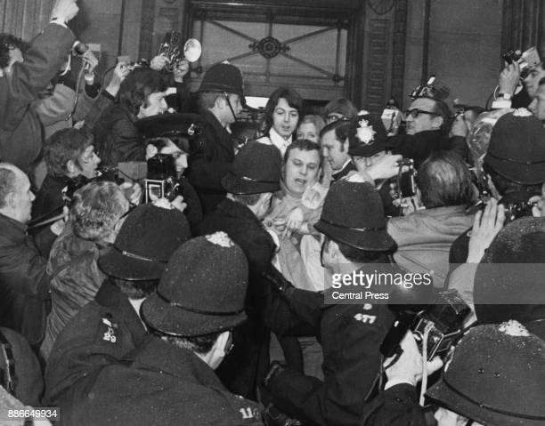 Singer and musician Paul McCartney of English rock band the Beatles leaves Marylebone Register Office in London with his wife photographer Linda...