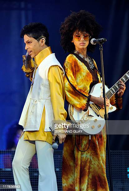 US singer and musician Prince and singer and guitarist Andy Allo perform on stage at the Stade de France in SaintDenis outside Paris on June 30 2011...