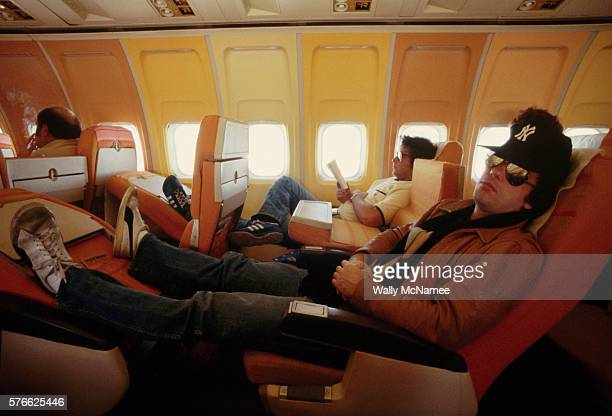 Singer and pianist Billy Joel rests on an airline flight between Austin and Dallas during a tour promoting his 57th Street album | Location Above...