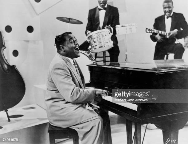 RB singer and pianist Fats Domino performs on a TV show circa 1958