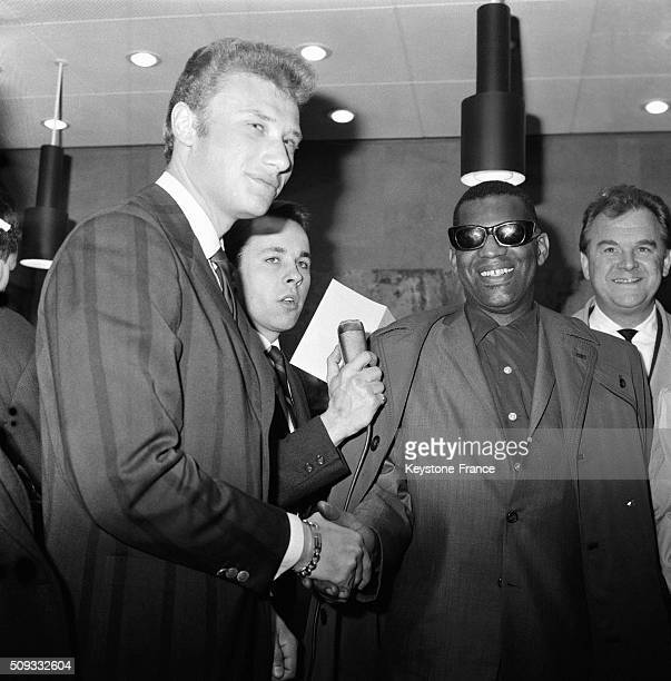 Singer And Pianist Ray Charles Arrives At Paris Orly Airport Welcomed By Singer Johnny Hallyday For Eight Galas At the Olympia Music Hall in Orly...