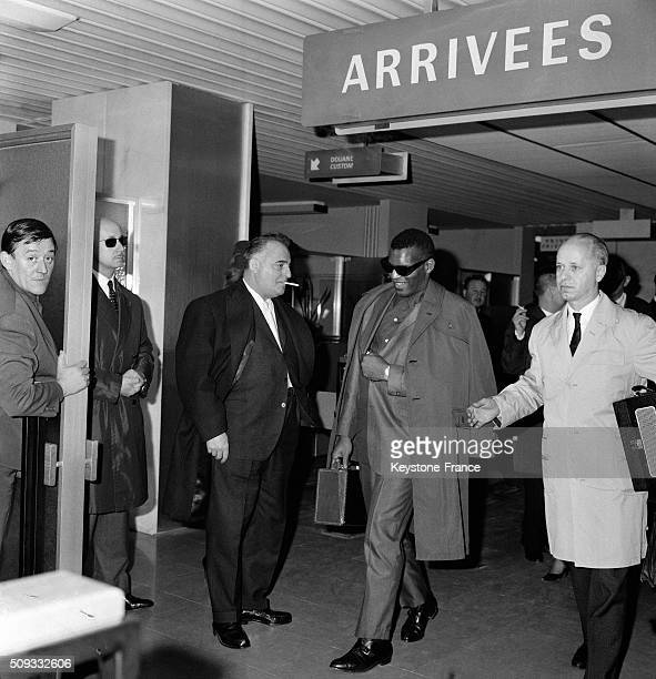 Singer And Pianist Ray Charles Welcomed By Olympia Music Hall Director Bruno Coquatrix At Paris Orly Airport Before Eight Galas At the Olympia in...