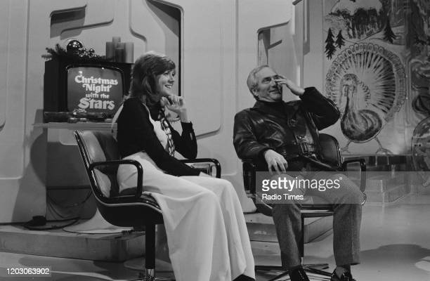Singer and presenter Cilla Black interviewing comedian Dick Emery for the BBC television special 'Christmas Night with the Stars' December 1970