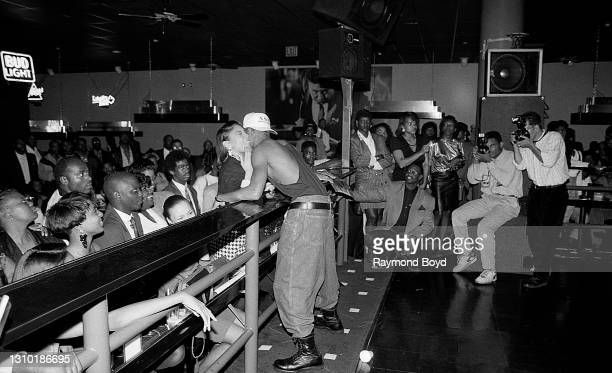 Singer and producer DeVanté Swing of Jodeci sings to a female fan while performing at The LaSalle Club in Chicago, Illinois in October 1991.