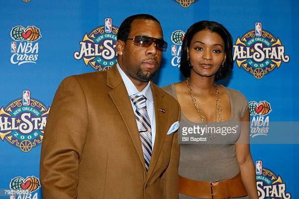 Singer and Producer Michael Bivins and his wife poses for a portrait on the red carpet prior to the 2008 NBA AllStar Game at the New Orleans Arena...