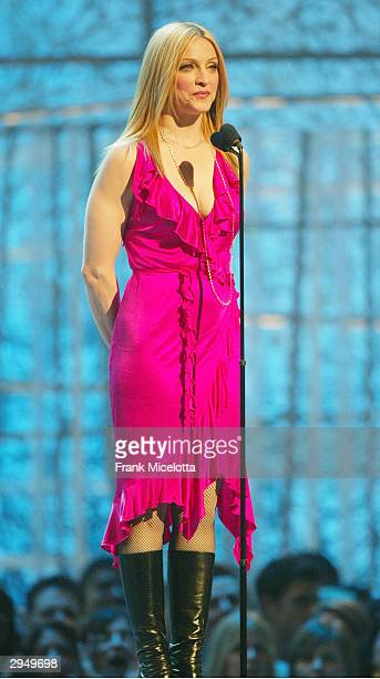 Singer and segment host Madonna speaks on stage at the 46th Annual Grammy Awards held at the Staples Center on February 8 2004 in Los Angeles...