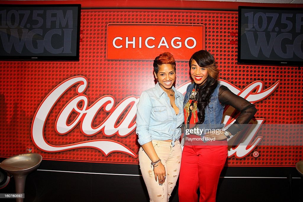 Singer and song writer RaVaughn, poses for photos with on-air personality Demi Lobo in the WGCI-FM 'Coca-Cola Lounge' in Chicago, Illinois on FEBRUARY