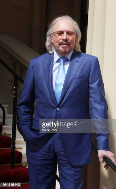 Singer and songwriter Barry Gibb poses for a photo ahead of being knighted during an investiture ceremony at Buckingham Palace on June 26 2018 in...