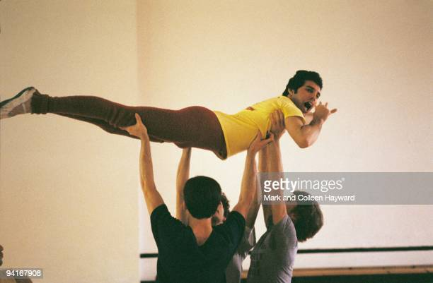 Singer and songwriter Freddie Mercury of British rock group Queen gets training from a ballet instructor August 1979