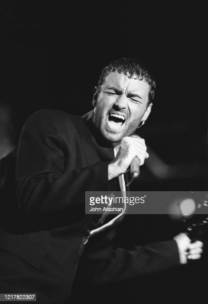 """Singer and songwriter George Michael is shown performing on stage during a """"live"""" concert appearance on January 25, 1991."""