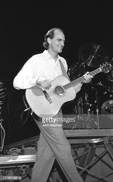 Singer and songwriter James Taylor is shown performing on stage during live concert appearance on July 24 1988