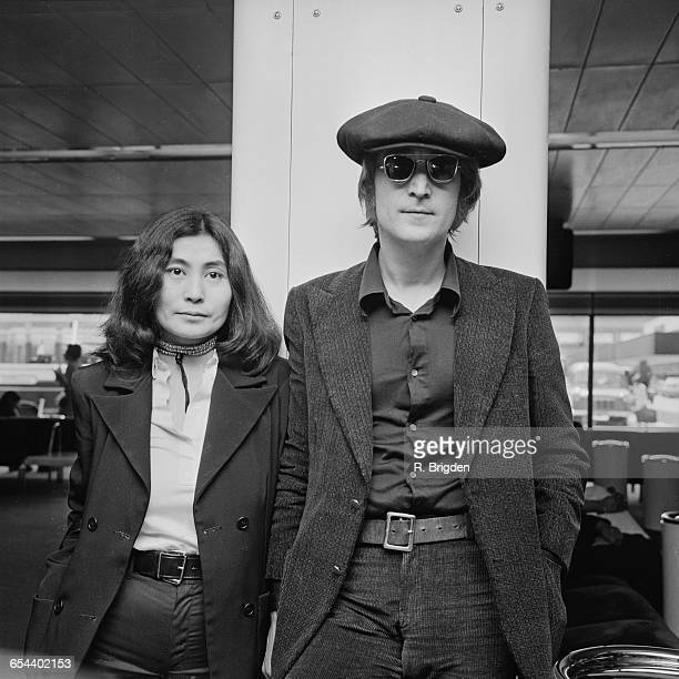 Singer and songwriter John Lennon and his wife Yoko Ono arrive at London Airport from New York, 14th July 1971.