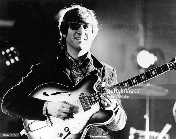 Singer and songwriter John Lennon at Abbey Road studios London during filming of a promotional video for the single 'Paperback Writer' and 'Rain'...