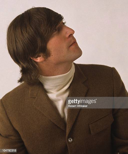 Singer and songwriter John Lennon of The Beatles posing during a studio session in Chelsea London March 1966