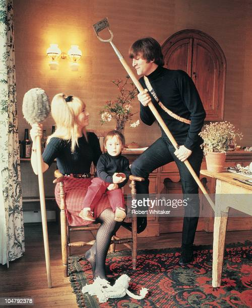 Singer and songwriter John Lennon of The Beatles with his first wife Cynthia and their son Julian at their home at Kenwood Weybridge Surrey 1964