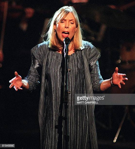 """Singer and songwriter Joni Mitchell performs onstage during the finale of Turner Network Television's """"All-Star Tribute to Joni Mitchell"""" at the..."""
