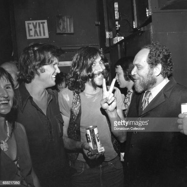 Singer and songwriter Kris Kristofferson and his guitarist chat with a man after their performance at the Bitter End nightclub in circa 1971 in New...