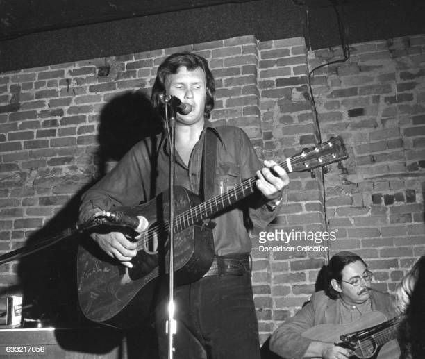 Singer and songwriter Kris Kristofferson performs onstage at the Bitter End nightclub in circa 1971 with a Martin acoustic guitar in New York New York