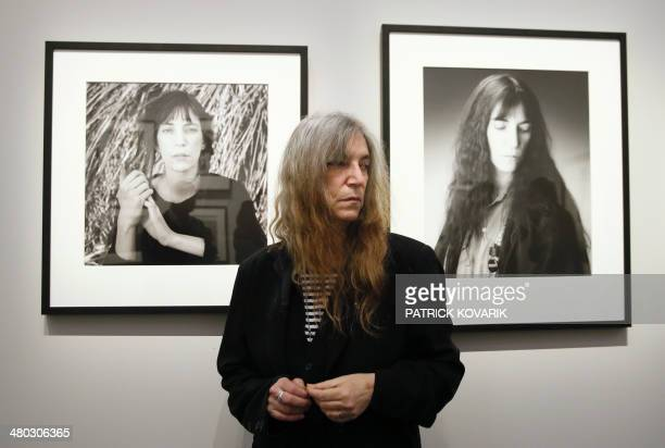 US singer and songwriter Patti Smith poses during the opening of an exhibition dedicated to the late US photographer Robert Mapplethorpe at the Grand...
