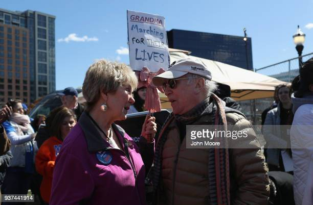Singer and songwriter Paul Simon speaks to nurse Stephanie Palmeno after Simon sang The Sound of Silence at the March for Our Lives rally on March 24...