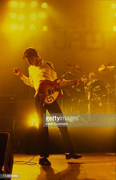 Singer and songwriter Paul Weller performing with The Jam circa 1980 Drummer Rick Buckler is at the kit