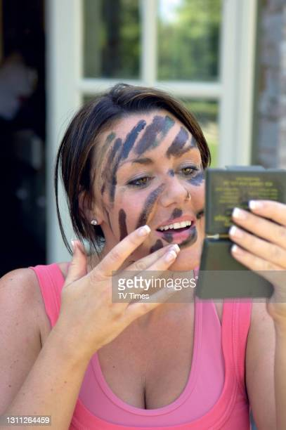 Singer and television personality Michelle Heaton applying camouflage face paint, June 14, 2008.