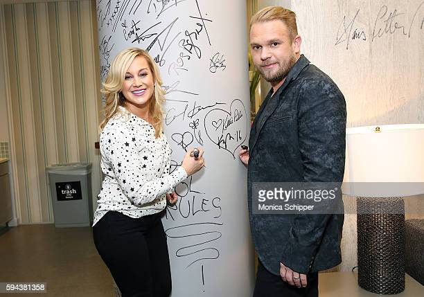 Singer and TV personality Kellie Pickler and songwriter Kyle Jacobs sign the wall at AOL HQ when they visit for AOL Build Presents Kellie Pickler and...