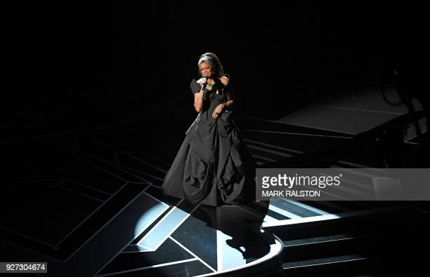 Singer Andra Day performs during the 90th Annual Academy Awards show on March 4, 2018 in Hollywood, California. / AFP PHOTO / Mark RALSTON
