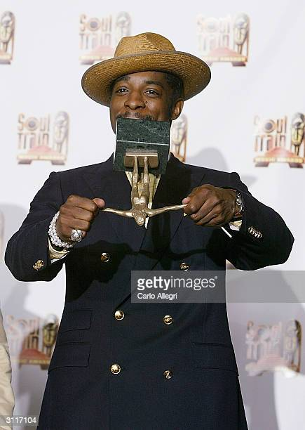 Singer Andre 3000 of 'Outkast' poses backstage in the press room at the 18th Annual Soul Train Music Awards after winning the Sammy Davis Jr Award...
