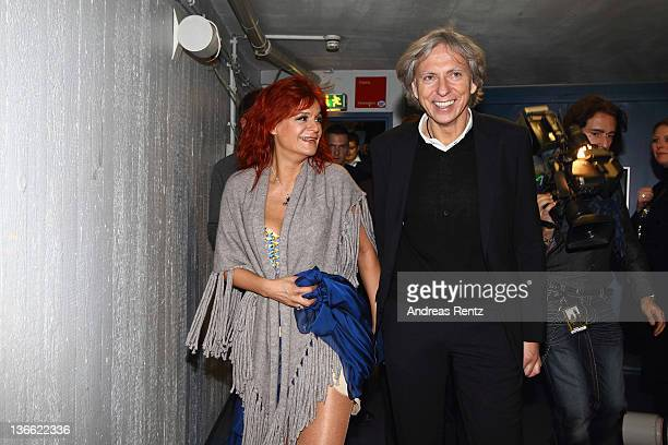 Singer Andrea Berg and her husband Uli Ferber smile after the 'Abenteuertour' 2012 premiere at HannsMartinSchleyerHalle on January 6 2012 in...