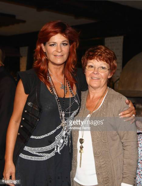 Singer Andrea Berg and her mother Helga attend the after show party during the 'Abenteuer' tour at the comtech Arena on July 21, 2012 in Aspach near...