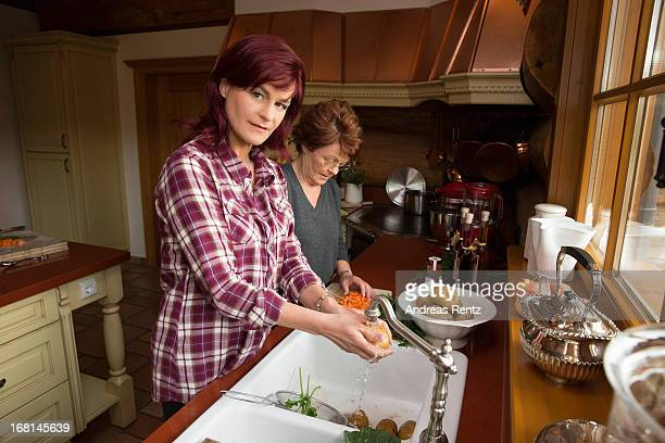 Singer Andrea Berg and her mother Helga Zellen clean vegetables on April 23 2013 in Stuttgart Germany Berg's cookbook 'Meine Seelenkueche' will be...