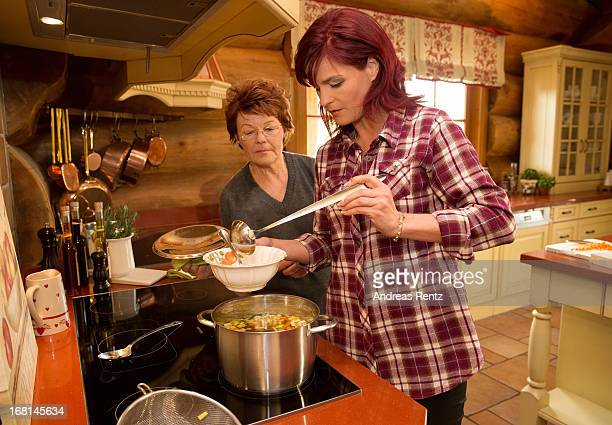 Singer Andrea Berg and her mother Helga Zellen prepare a soup on April 23 2013 in Stuttgart Germany Berg's cookbook 'Meine Seelenkueche' will be...