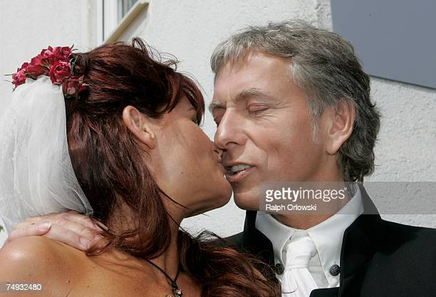 Singer Andrea Berg and her newlywed husband Uli Ferber smile after their wedding ceremony on June 27 2007 in KleinAspach near Heilbronn Germany