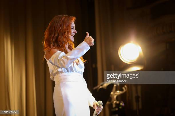 Singer Andrea Berg performs on stage during her first concert of her 'Hautnah' tour in the Laeiszhalle in Hamburg Germany 16 October 2017 With her...
