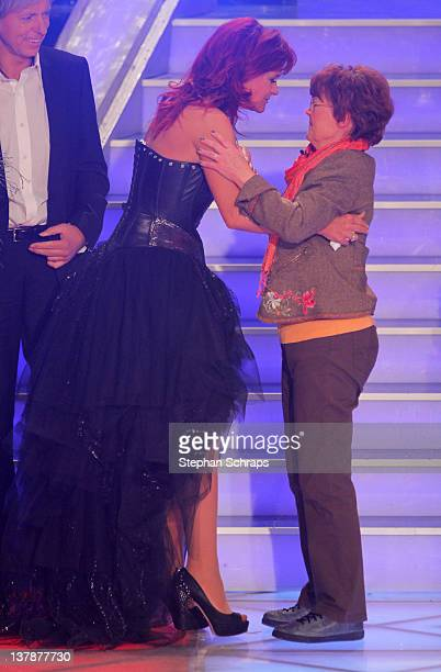 Singer Andrea Berg receives congratulations to her 45th birthday from her mother Helga Zellen during the MDR 'Winterfest der fliegenden Stars' at the...