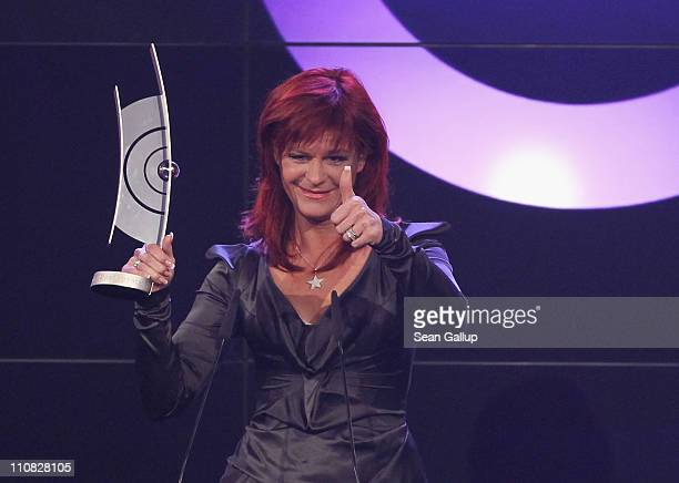 Singer Andrea Berg speaks after receiving her German Speaking Schlager Female Artist Award at the Echo Awards 2011 at Palais am Funkturm on March 24...