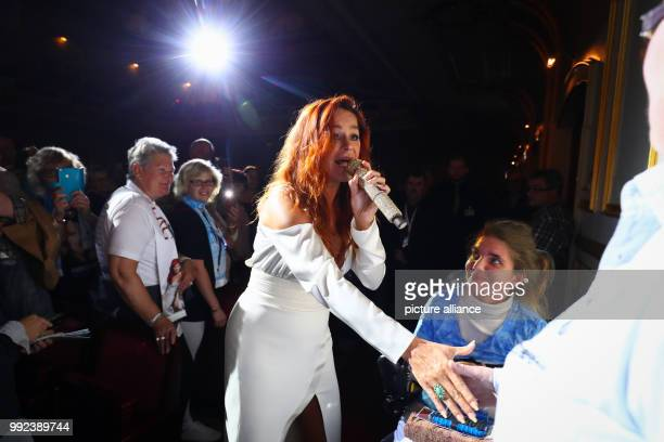 Singer Andrea Berg walks across the audience during her first concert of her 'Hautnah' tour in the Laeiszhalle in Hamburg Germany 16 October 2017...