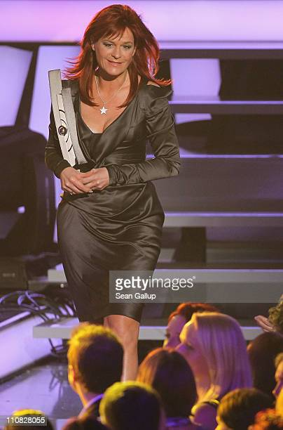 Singer Andrea Berg walks offstage after receiving her German Speaking Schlager Female Artist Award at the Echo Awards 2011 at Palais am Funkturm on...