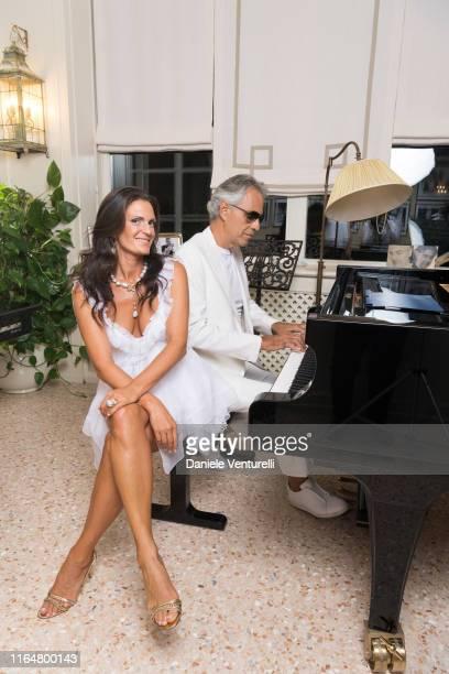 Singer Andrea Bocelli and Veronica Berti Pose at the Andrea Bocelli Celebrity Fight Night 2019 on July 28, 2019 in Forte dei Marmi, Italy.