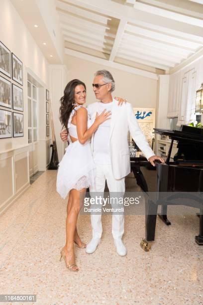 Singer Andrea Bocelli and Veronica Berti Pose at the Andrea Bocelli Celebrity Fight Night 2019 on July 28 2019 in Forte dei Marmi Italy