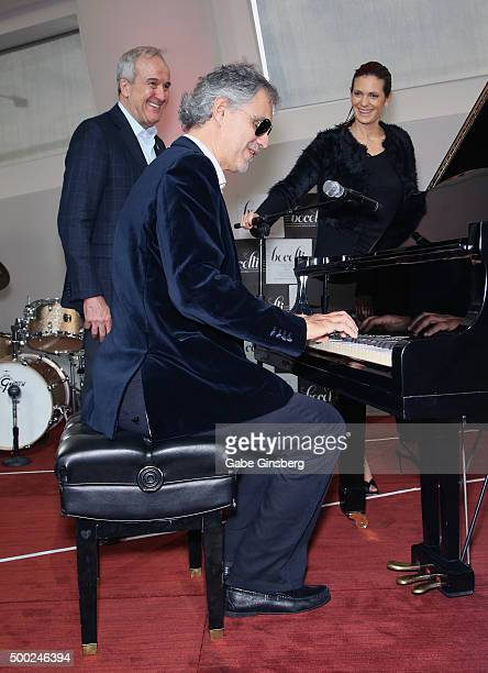 Singer Andrea Bocelli performs as Keep Memory Alive Founder Larry Ruvo and Veronica Bocelli watch during an unveiling of a life-sized statue of...